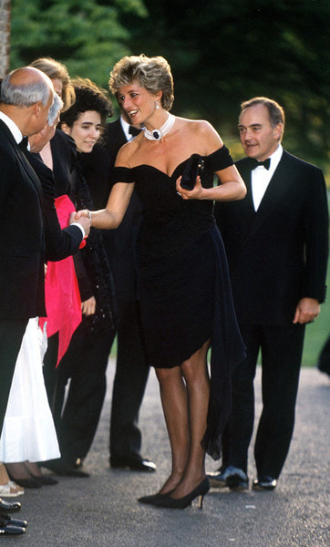 Princess Diana (1961 - 1997) arriving at the Serpentine Gallery, London, in a gown by Christina Stambolian, June 1994. Standing behind her is property developer and art collector Peter Palumbo. (Photo by Jayne Fincher/Getty Images)