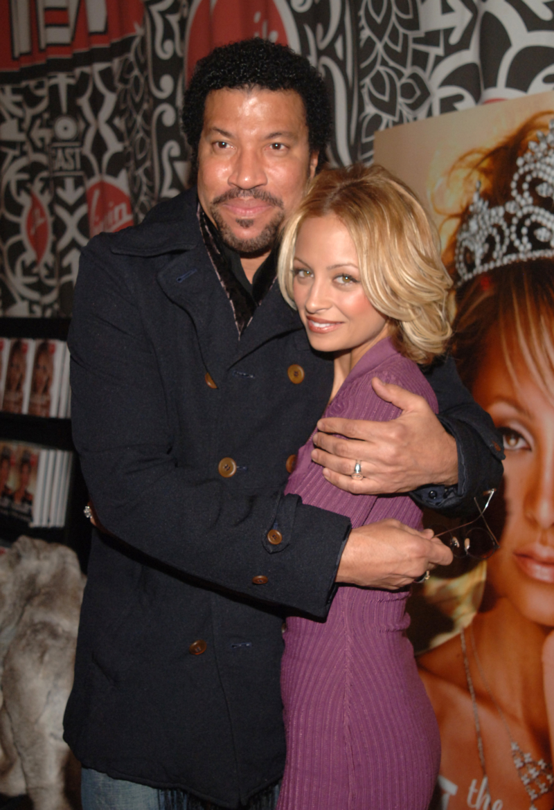 """NEW YORK - NOVEMBER 10: Lionel Richie and Nicole Richie share a moment at the """"The Truth About Diamonds"""" book signing at the Virgin Mega Store in Times Square on November 10, 2005 in New York City. (Photo by Brad Barket/Getty Images)"""