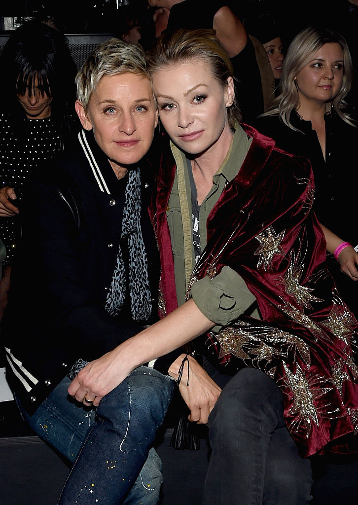 LOS ANGELES, CA - FEBRUARY 10: TV personality (L) Ellen DeGeneres, in Saint Laurent by Hedi Slimane, and actress Portia de Rossi, in Saint Laurent by Hedi Slimane, attend Saint Laurent at the Palladium on February 10, 2016 in Los Angeles, California for the Saint Laurent Los Angeles show. (Photo by Larry Busacca/Getty Images for SAINT LAURENT)